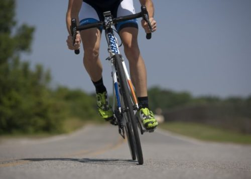 Man in Bike - Physical Activity to lessen cancer risk